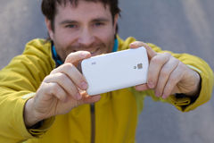 Man with beard and mobilephone. The man with beard and white mobilephone Royalty Free Stock Images
