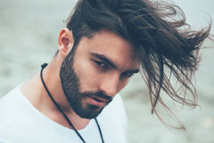Man with beard and modern hairstyle. Portrait of a man with beard and modern hairstyle Stock Photography