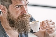 Man with beard and mustache and cup of coffee. Bearded guy relaxing at cafe terrace. Guy relaxing with espresso coffee stock image
