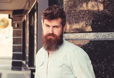 Man with beard and mustache on strict, serious or disgusting face, black marble background. Masculinity concept. Hipster. With tousled hair and long beard stock photos