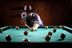 A man with a beard plays a big billiard. Party in a 12-foot pool. A man with a beard plays a big billiard. Party in 12-foot pool. Billiards in the club game for Royalty Free Stock Photography