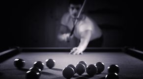 A man with a beard plays a big billiard. Party in a 12-foot pool Royalty Free Stock Photo