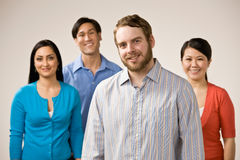 Man with beard posing with friends stock images
