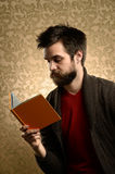 Man With Beard Reading Stock Photo