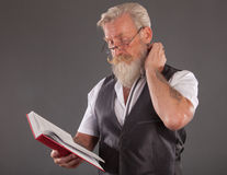 Man with beard reding a book Royalty Free Stock Photo