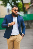 Man with a beard smokes electronic cigarette Royalty Free Stock Image