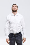 Man with beard standing and looking up Stock Photos