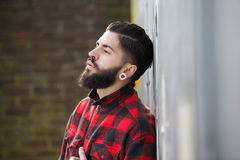 Man with beard standing outdoors alone Royalty Free Stock Photo
