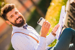 Man with beard. Stylish young man with a beard, a walk in the park Royalty Free Stock Photos