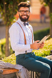 Man with beard. Stylish young man with a beard, a walk in the park Royalty Free Stock Photography