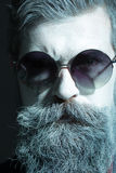 Man with beard in sun glasses Royalty Free Stock Images