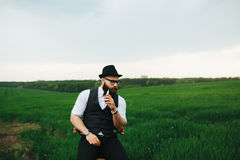Man with a beard, thinking in the field Stock Photos
