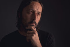 Man with beard thinking, low key portrait Stock Photo