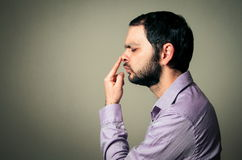 Man with beard touching  nose Royalty Free Stock Photography