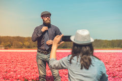 Man with beard in a tulip field Stock Photography