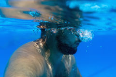 Man with Beard Underwater swimming pool Young beard man with glasses Underwater Royalty Free Stock Photos