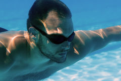Man with Beard Underwater swimming pool Young beard man with glasses Underwater Stock Photo