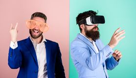 Man with beard in VR glasses and louvered plastic accessory. Guy interact in virtual reality. Hipster exploring virtual. Reality. Business implement modern royalty free stock photography