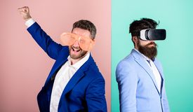 Man with beard in VR glasses and louvered plastic accessory. Guy interact in virtual reality. Hipster exploring virtual. Reality. Real fun and virtual royalty free stock image