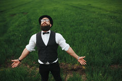 Man with a beard walking on the field Stock Photo