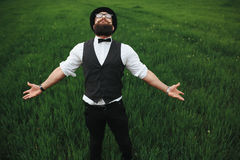 Man with a beard walking on the field Royalty Free Stock Photo