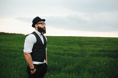 Man with a beard walking on the field Royalty Free Stock Image