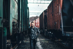 Man with beard walking on the railway royalty free stock photos