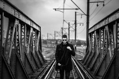 Man with beard walking on the railway Stock Photos