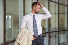 Man with beard is wearing shirt and tie Stock Photos