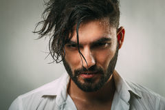 Man with a beard and wet face. Portrait of a man with a beard and wet face Stock Photos