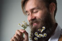 Man with beard in white shirt and suspenders stock photos