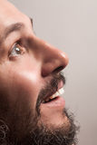 Man with beard and white teeth. Happy smiling adult man with beard and white teeth close-up portrait Stock Image