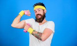 Man bearded athlete exercising dumbbell. If you want to be strong. Motivated athlete guy. Sportsman retro outfit. Training blue background. Join my sport class stock photography