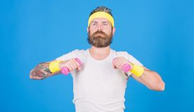 Man bearded athlete exercising dumbbell. Sportsman retro outfit training blue background. Athlete on way to strong body royalty free stock images