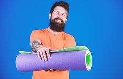 Man bearded athlete hold fitness mat. Fitness and stretching. Having good stretch. Athlete yoga coach motivated for. Training. Yoga class concept. Yoga as hobby royalty free stock photos
