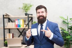 Man bearded businessman hold coffee cup stand office background. Successful people drink coffee. Drinking coffee. Relaxing break. Boss enjoying energy drink stock images