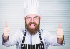 Man bearded chef getting ready cooking delicious dish. Chef at work starting shift. Guy in professional uniform ready stock images