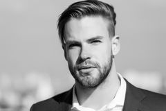 Man with bearded face on sunny outdoor. Businessman with stylish haircut on blurred sky. Business fashion, style and. Trend. Grooming and hair care in stock images