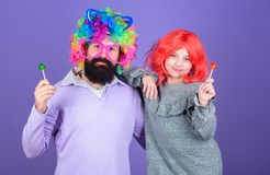 Man bearded father and girl wear colorful wig while eat lollipop candy. Thing loving father do for children. Tribute to. Fun dad. Easy simple ways be fun stock photos