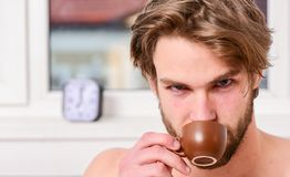 Man bearded handsome macho hold cup of coffee. Guy attractive appearance man enjoy hot fresh brewed coffee. First thing. In morning. Best time to have your cup royalty free stock images