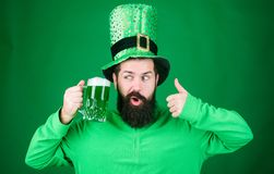 Man bearded hipster drink beer. Irish pub. Highly recommend. Drinking beer celebration. Fest and holiday menu. Dyed. Green traditional beer. Patricks day party royalty free stock image