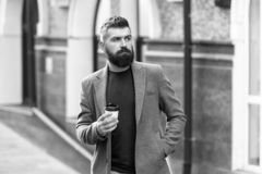 Man bearded hipster drinking coffee paper cup. One more sip of coffee. Drinking coffee on the go. Businessman stock photos