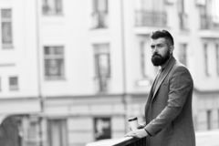 Man bearded hipster drinking coffee paper cup. One more sip of coffee. Enjoying coffee on the go. Businessman well royalty free stock photo