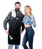 Man bearded hipster and girl. Preparation and culinary. Couple in love hold kitchen utensils. Tools for roasting meat royalty free stock photos