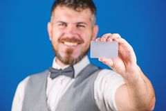 Man bearded hipster hold blank card blue background. Take this card. Make shopping easy. Which bank credit card easy get. Banking and credit concept. Plastic royalty free stock photo