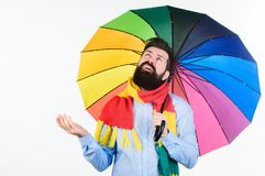 Man bearded hipster hold colorful umbrella. It seems to be raining. Rainy days can be tough to get through. Prepared for. Rainy day. Carefree and positive stock photography