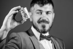 Man bearded hipster hold rolled dollars banknotes. Guy formal suit offer bribe or purchase. Easy money concept. Rich. Businessman hold rolled money. Hipster stock photos