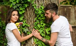 Man bearded hipster holds hand girlfriend. Couple in love romantic date walk nature tree background. Love relations. Romantic feelings. Park best place for royalty free stock image