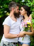 Man bearded hipster hugs gorgeous girlfriend. Couple love romantic date nature park background. Love relations romantic. Feelings. Gentle kiss. Couple in love stock photography