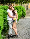 Man bearded hipster hugs gorgeous girlfriend. Couple in love romantic date walk nature park background. Love relations. Romantic feelings. Tender romantic royalty free stock images